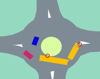 Truck with trailer in small roundabout